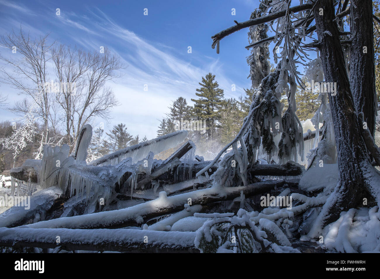 Barricade  of ice covered logs - Stock Image