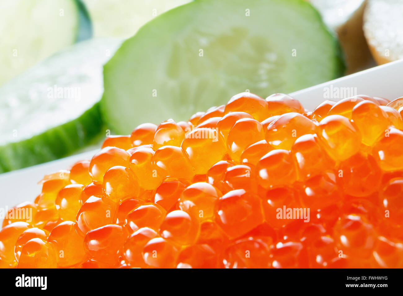 red caviar with cucumbers. - Stock Image