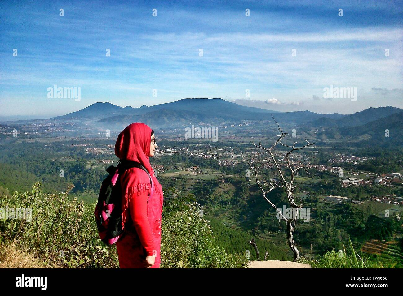 Woman Wearing Hijab Standing On Mountain - Stock Image