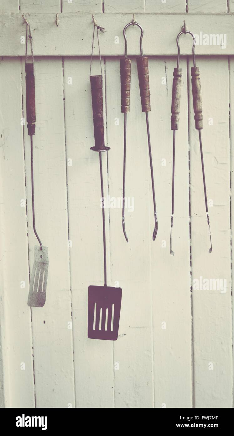 Close-Up Of Barbeque Tools Hanged On Hook - Stock Image