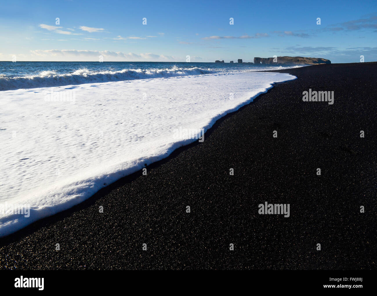 Wave Reaching Shore Against Sky - Stock Image