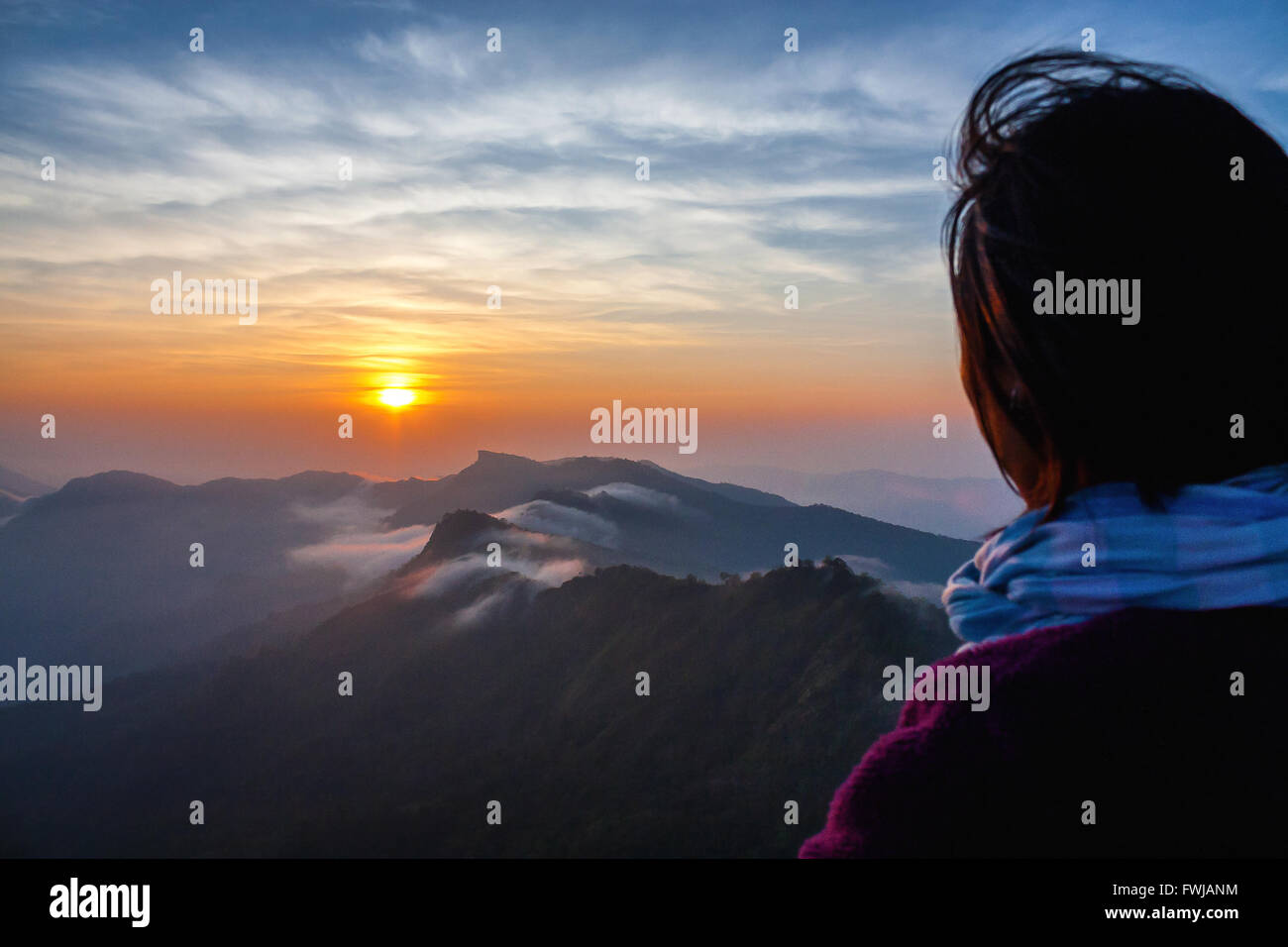 Rear View Of Person Against Mountains During Sunset - Stock Image