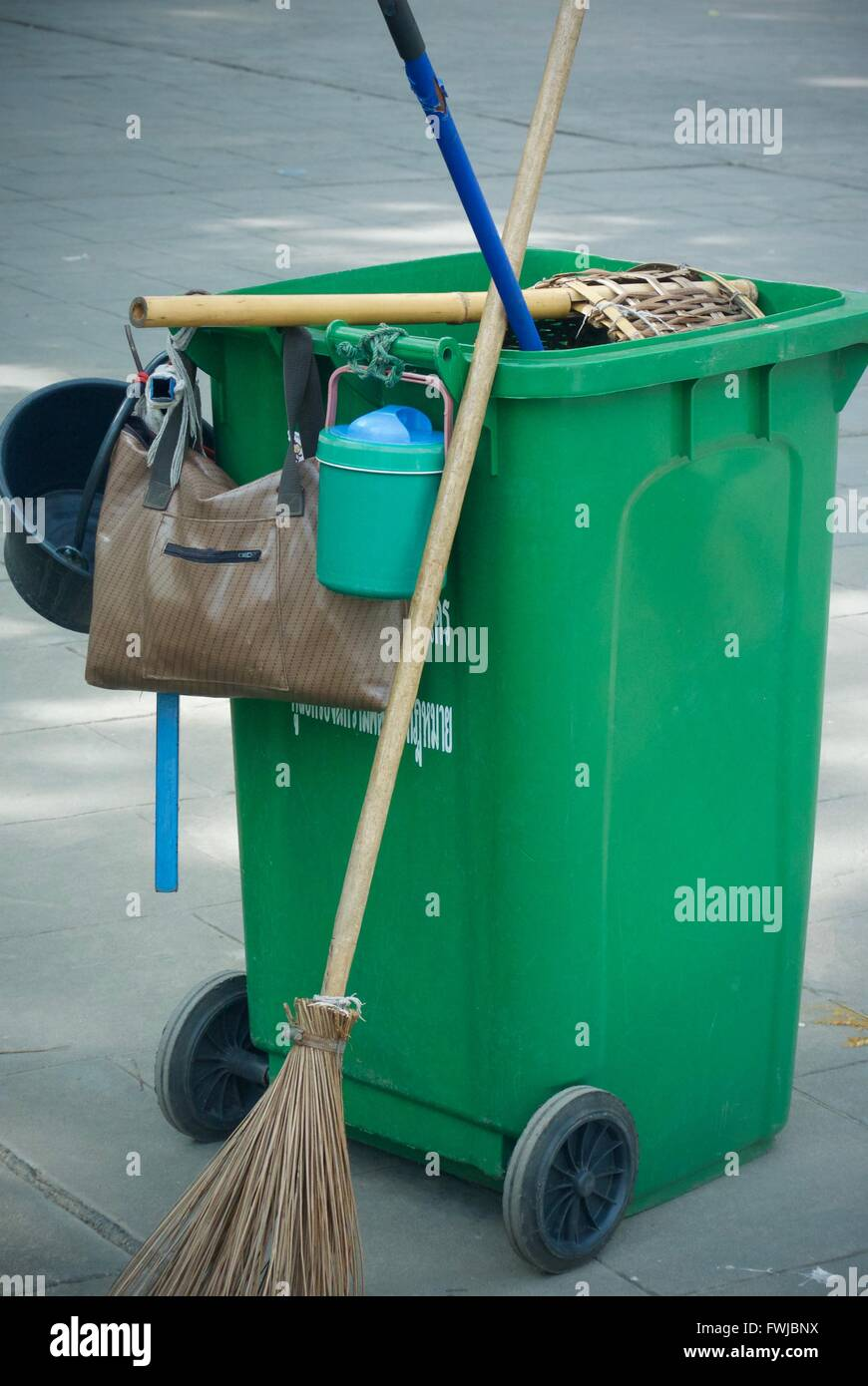 Garbage Can And Broom On Street - Stock Image