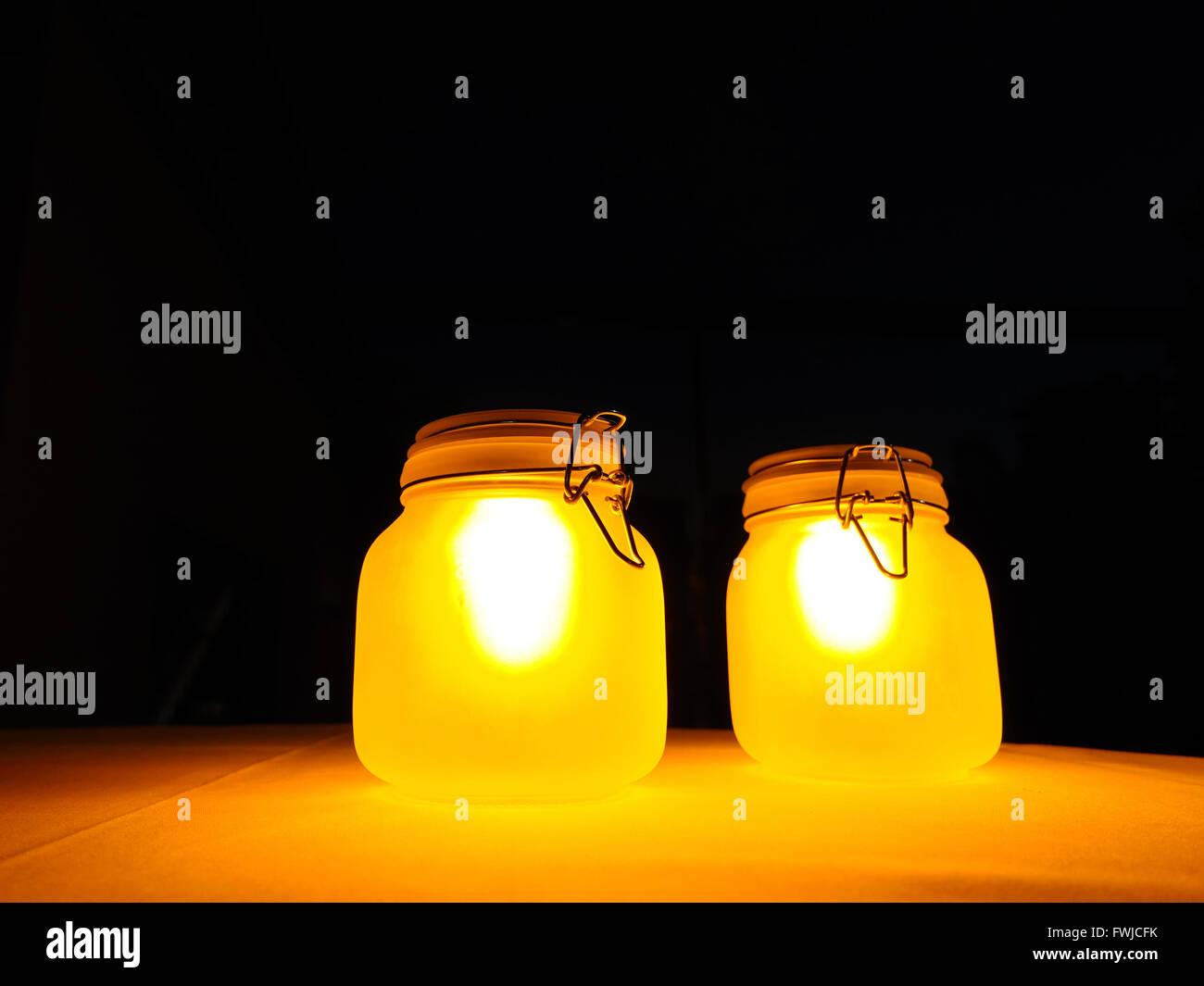 Close-Up Of Illuminated Lanterns On Table At Night - Stock Image