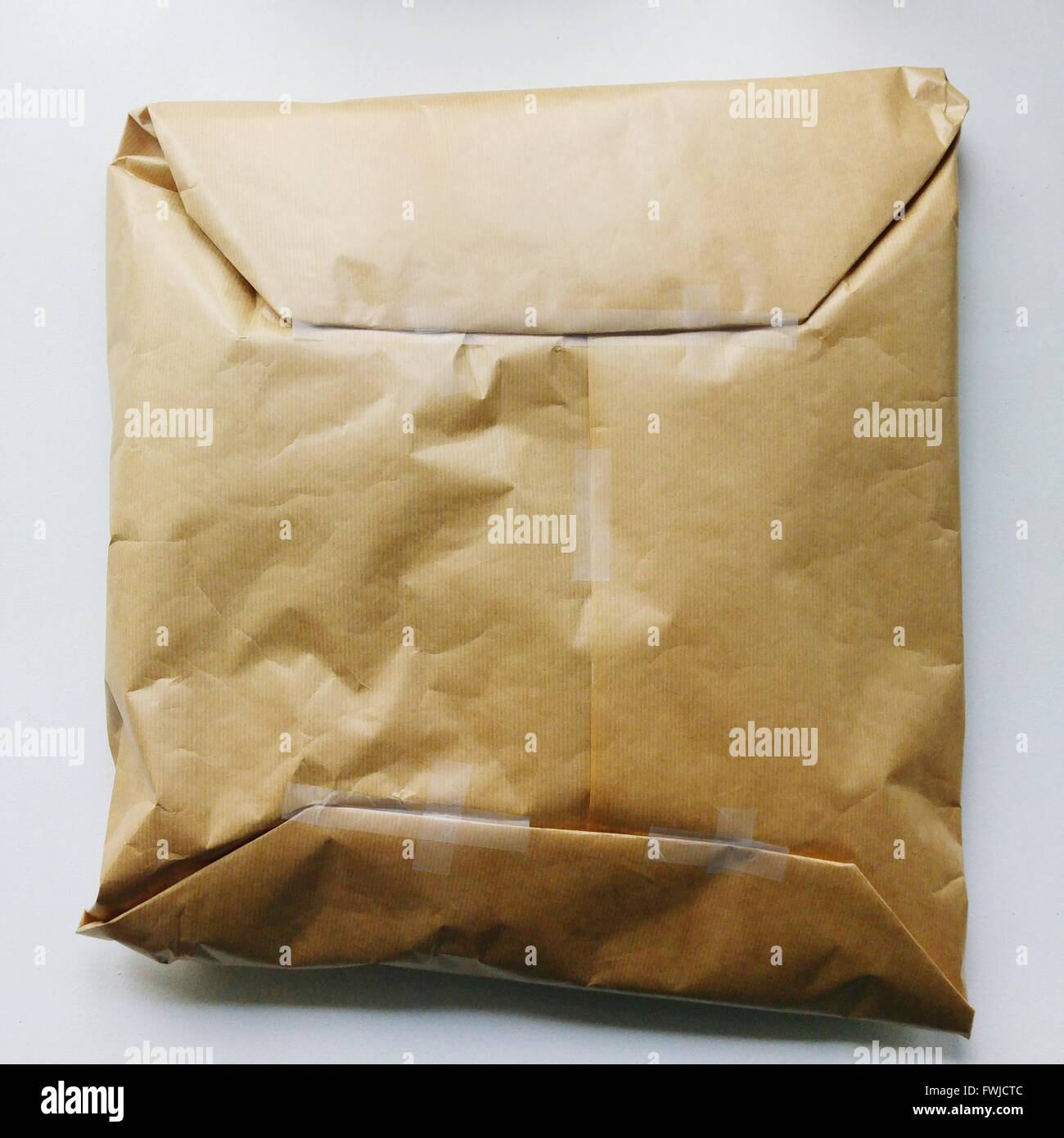 Close-Up Of Package Against White Background - Stock Image
