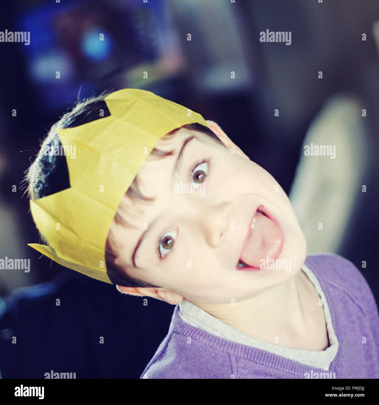 6b9b20b5e0edc Close-Up Portrait Of Boy Wearing Paper Crown During Christmas Stock ...