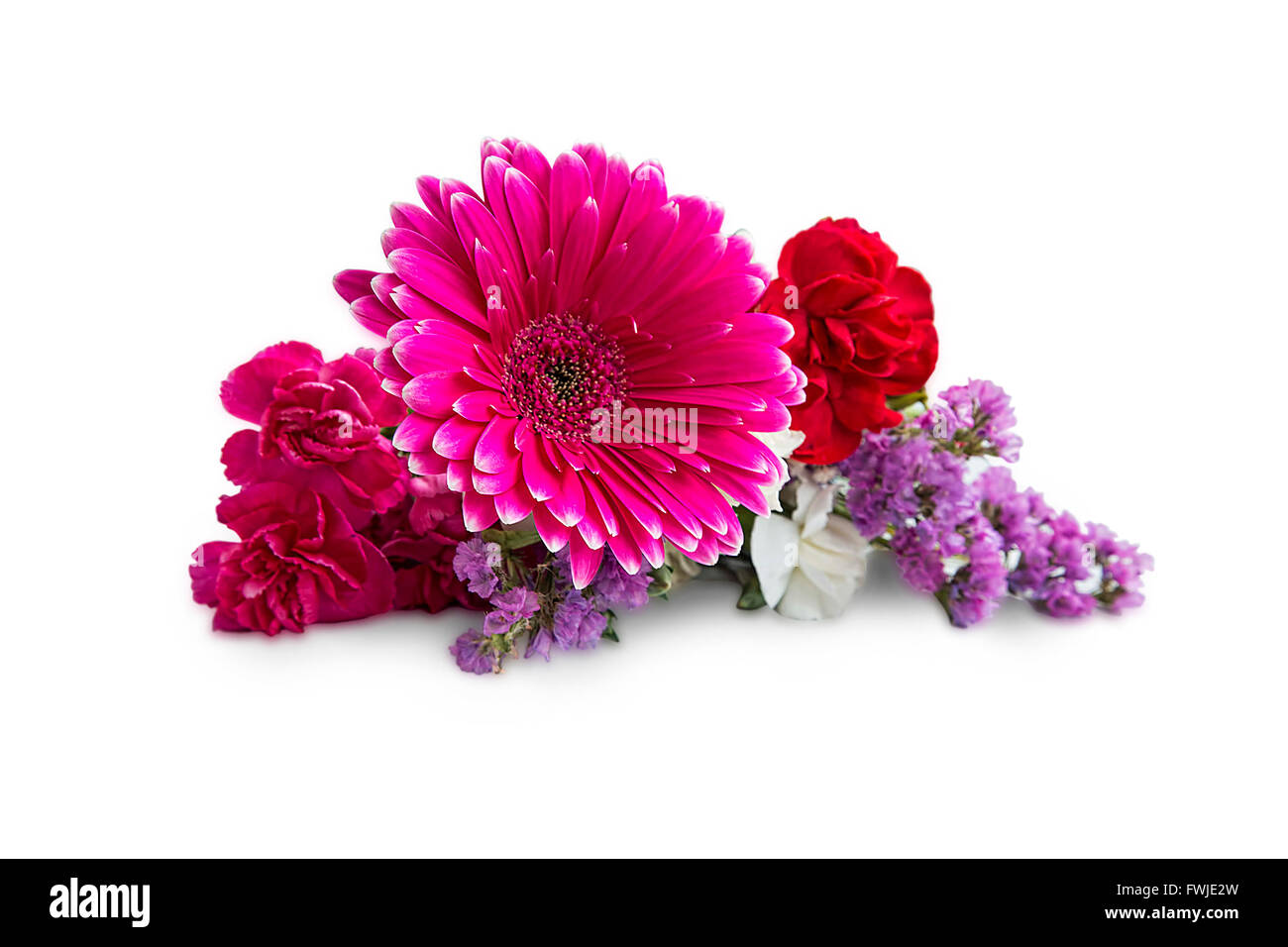 Spring bouquet flowers with gerbera,carnations and purple flowers isolated on white - Stock Image
