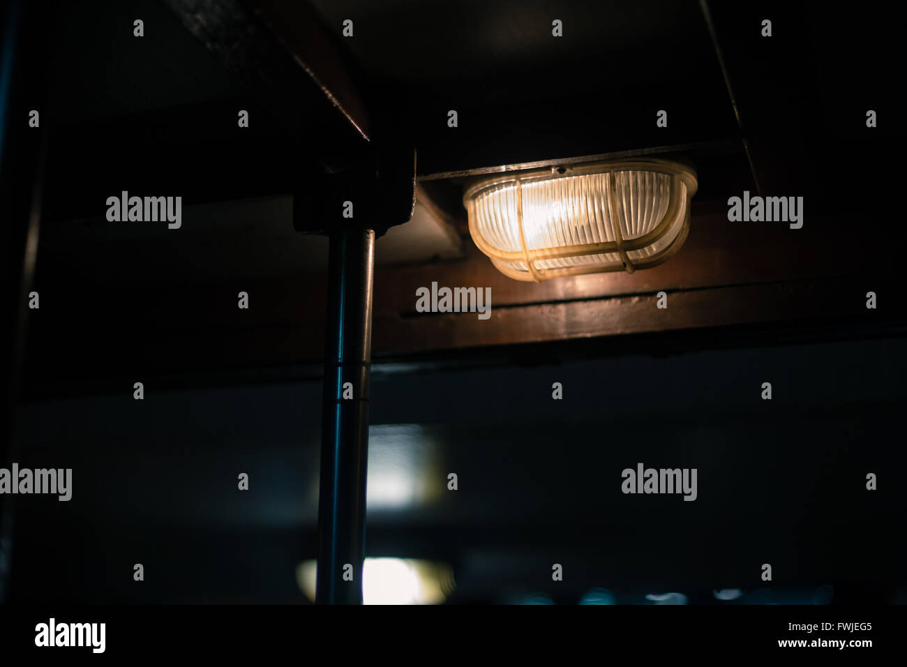 Low Angle View Of Illuminated Light Fixture On Ceiling - Stock Image