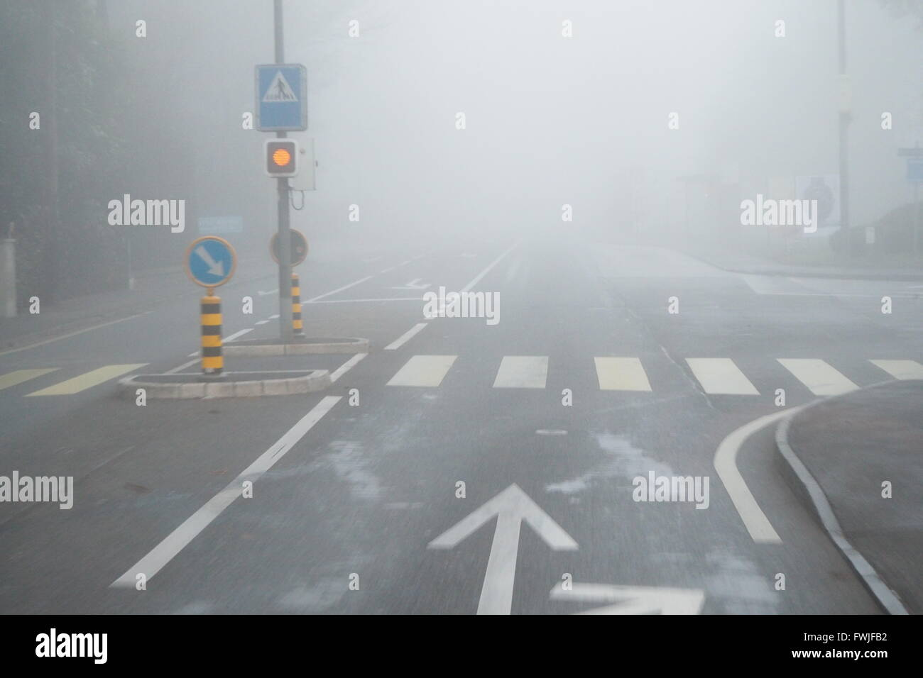 Markings On Empty Road During Foggy Weather - Stock Image