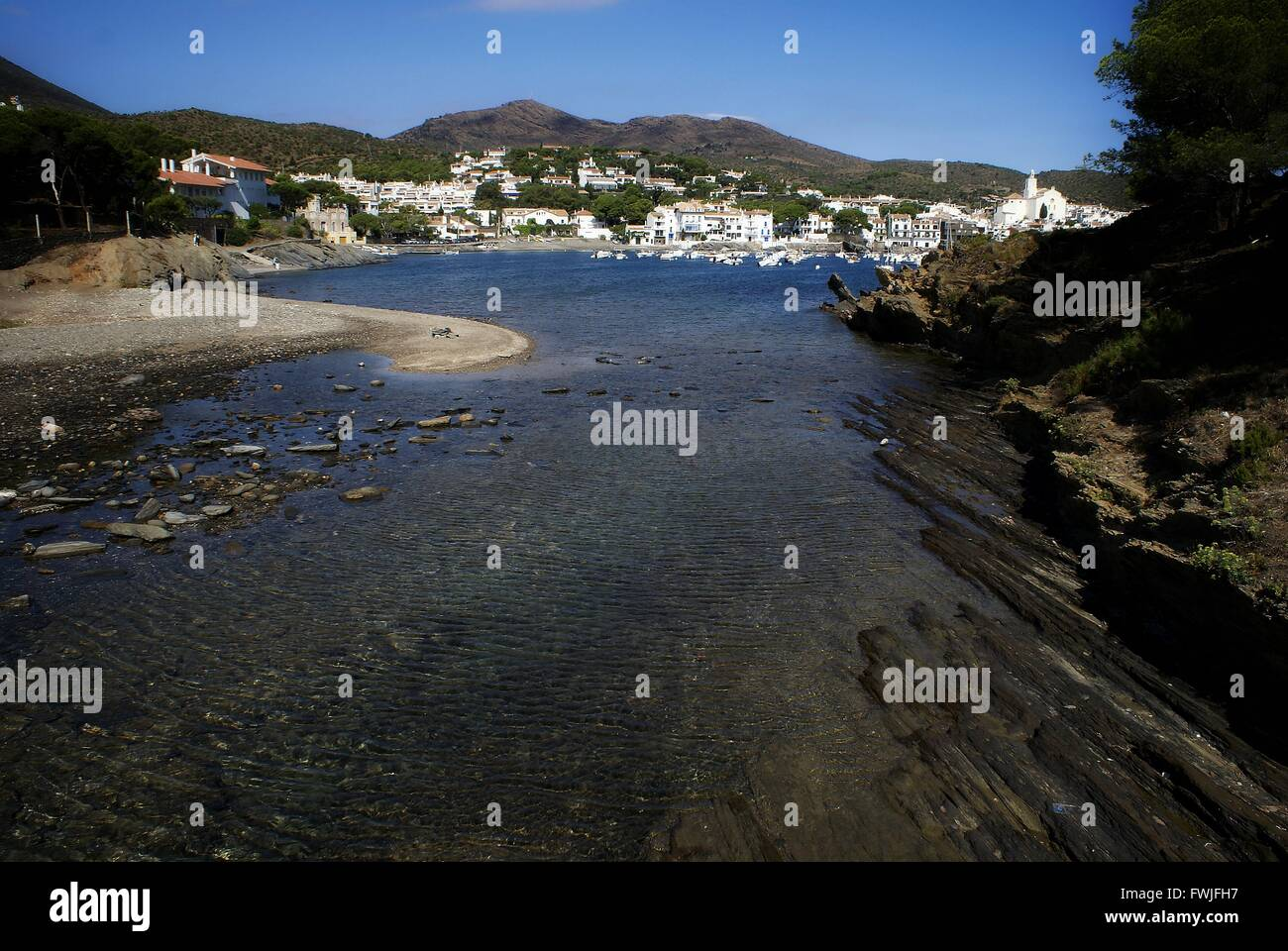 River By Houses Against Sky - Stock Image