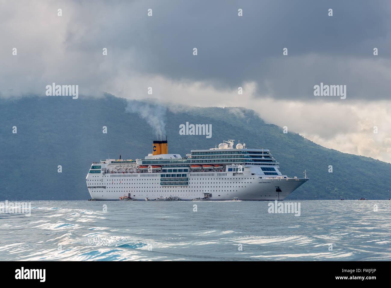 Costa Neoromantica Cruise ship anchored at Hell-Ville, Nosy Be Island, Madagascar. - Stock Image