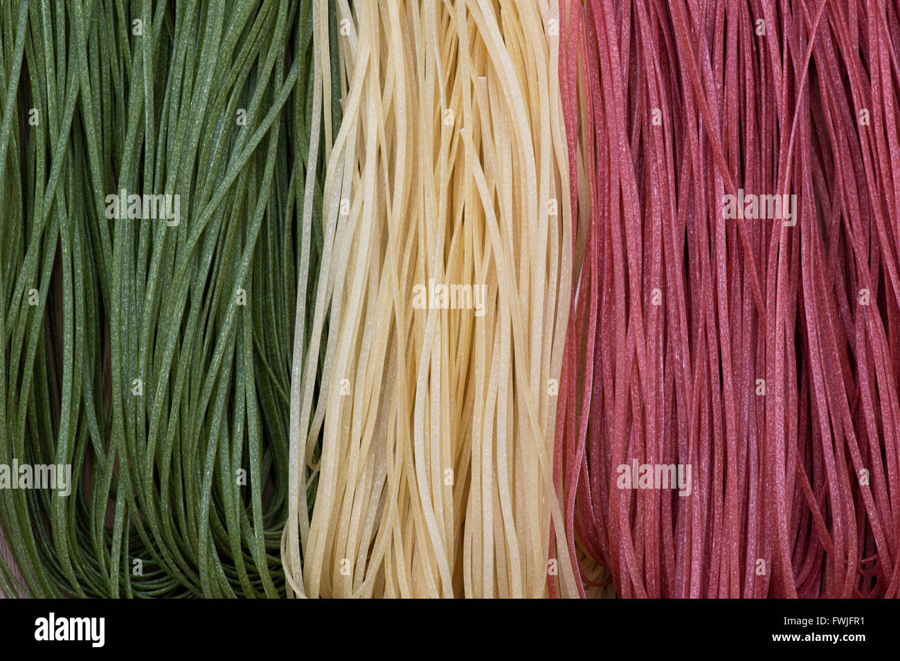 Linguine pasta in 3 flavours. The colours represent the Italian flag - Stock Image
