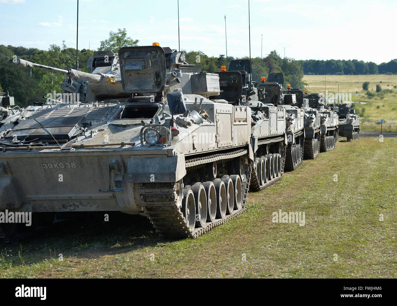 A line of Warrior vehicles wait for a call to action on Salisbury Plain during Exercise Lion Strike. Stock Photo