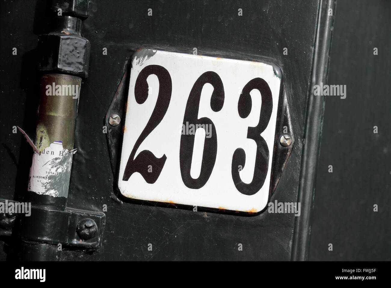 Close up of the door number on 263 Prinsengracht, the WW2 home Anne Frank House & annex in Amsterdam, Netherlands. - Stock Image