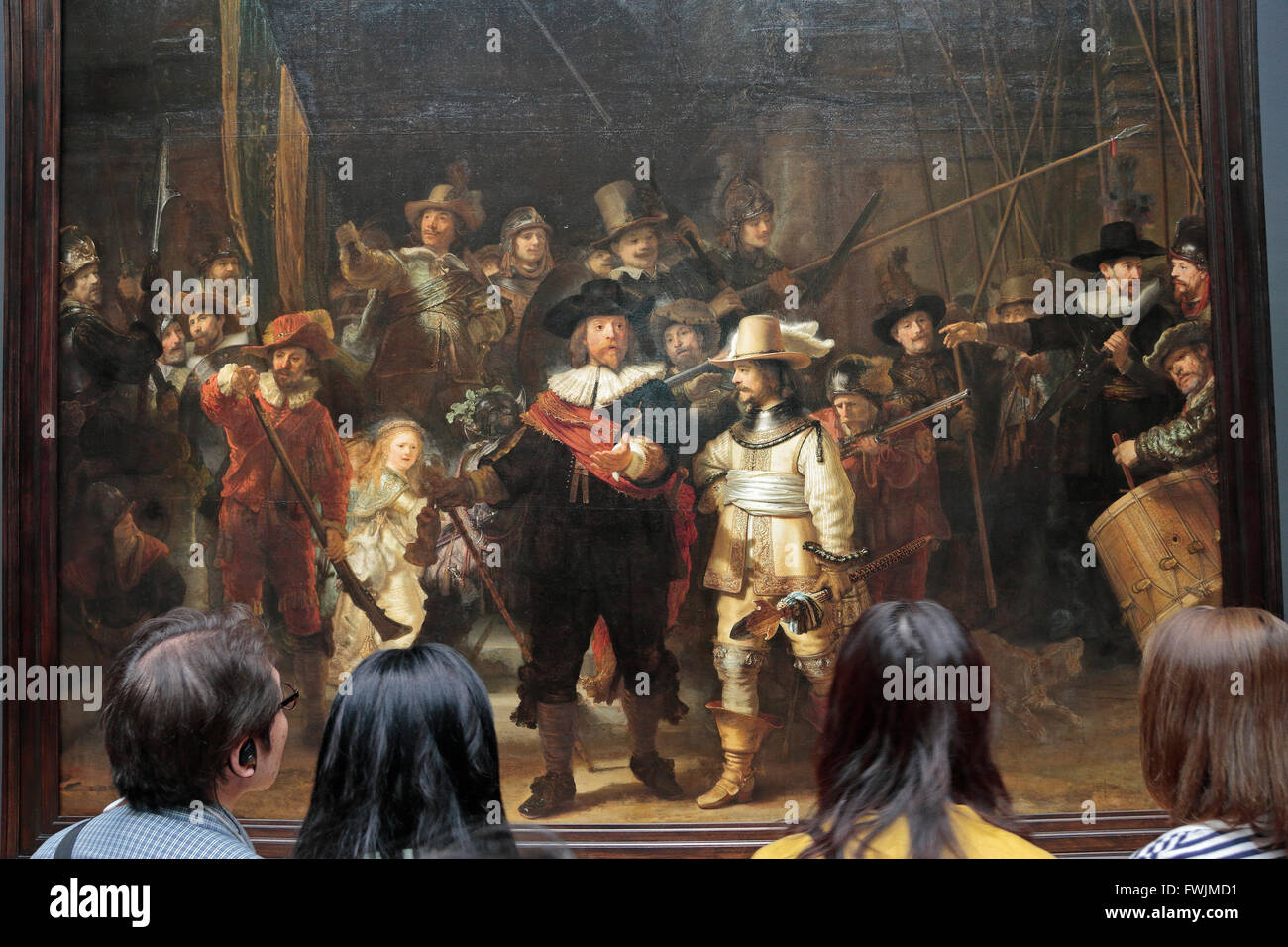 "Visitors look closely at ""The Night Watch,"" (1642) by Rembrandt van Rijn in  the Rijksmuseum, Amsterdam, Netherlands."
