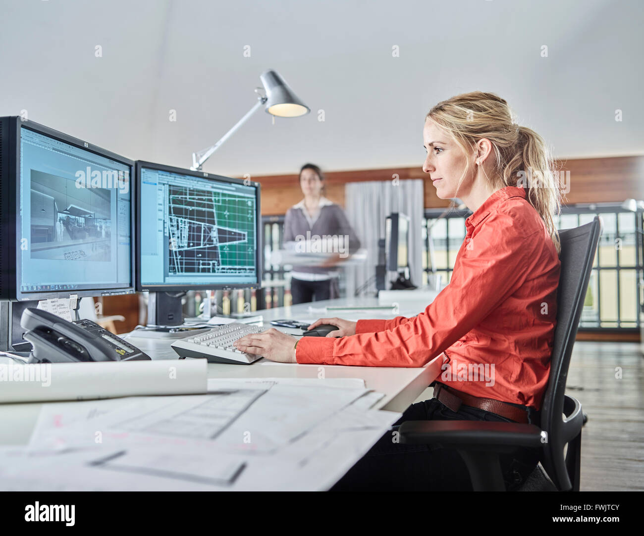 Architect sitting at the computer at work, Austria - Stock Image