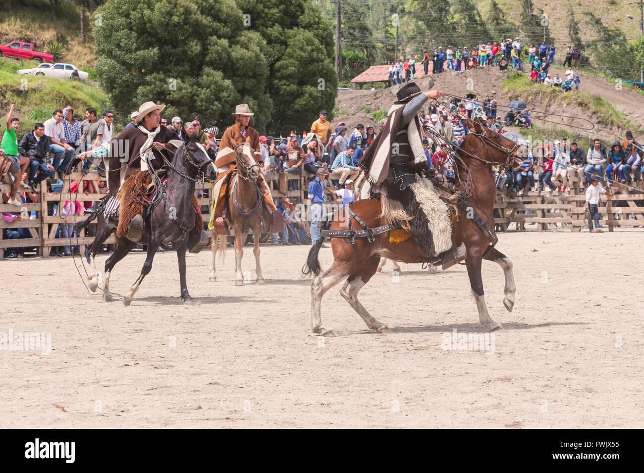 Banos, Ecuador - 30 November 2014: Group Of Latin Indigenous Cowboys Riding A Horse, South America In Banos On November Stock Photo