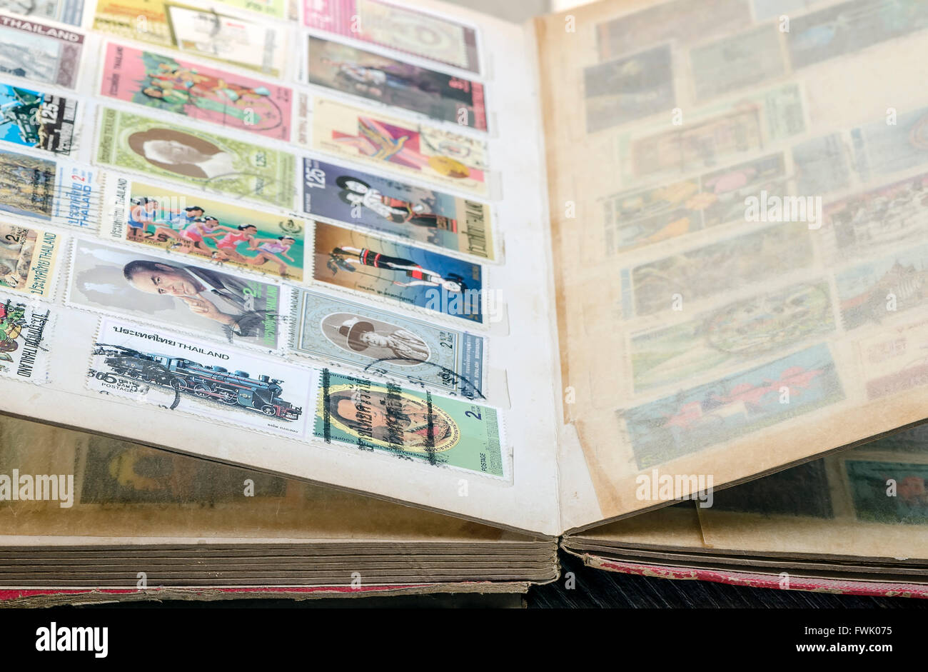 The old stamp book   in close up view,soft focus. - Stock Image