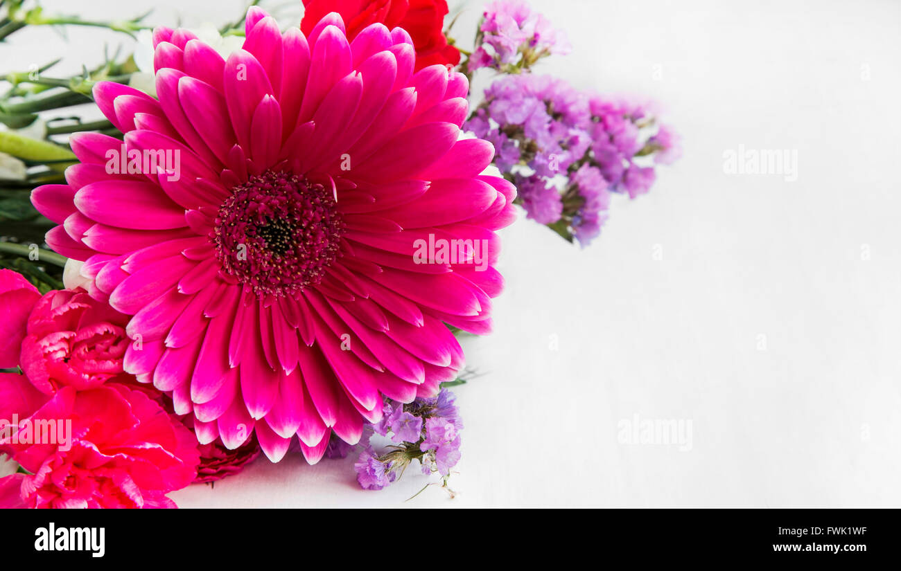 Spring bouquet flowers with gerbera,carnations and purple flowers - Stock Image