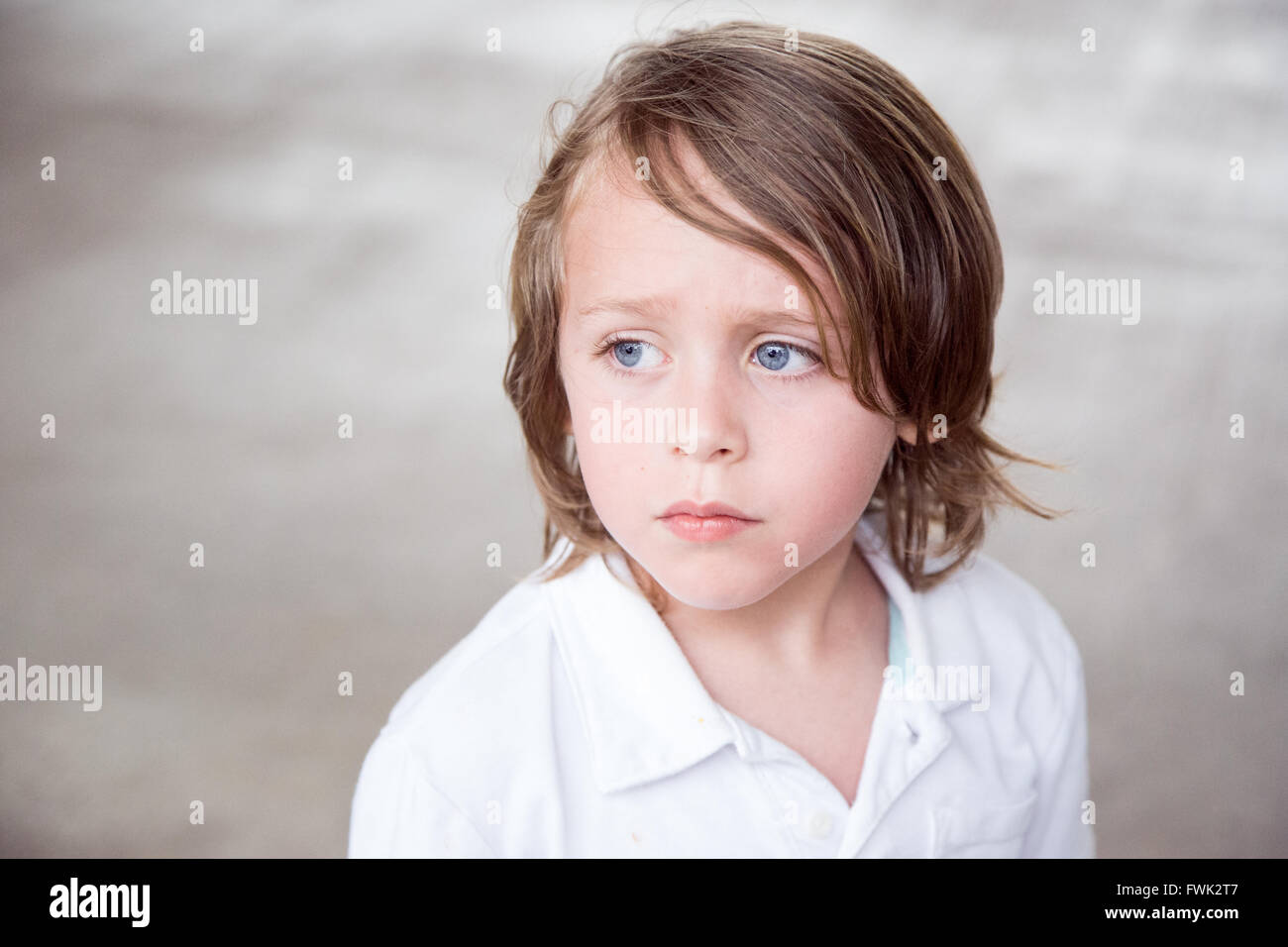 Close-Up Of Boy Looking Away - Stock Image
