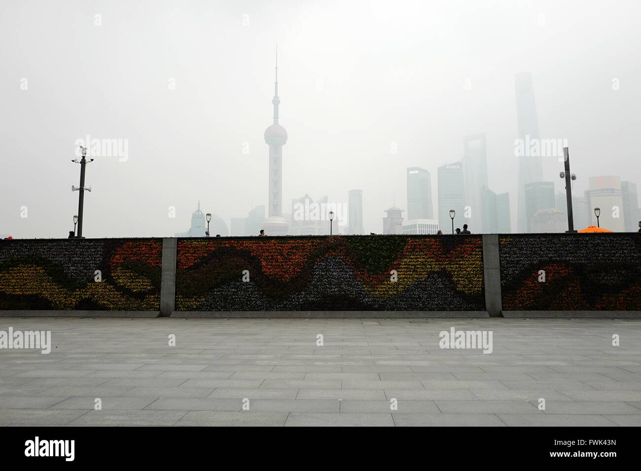 Graffiti On Wall By Street Against Cityscape In Foggy Weather - Stock Image