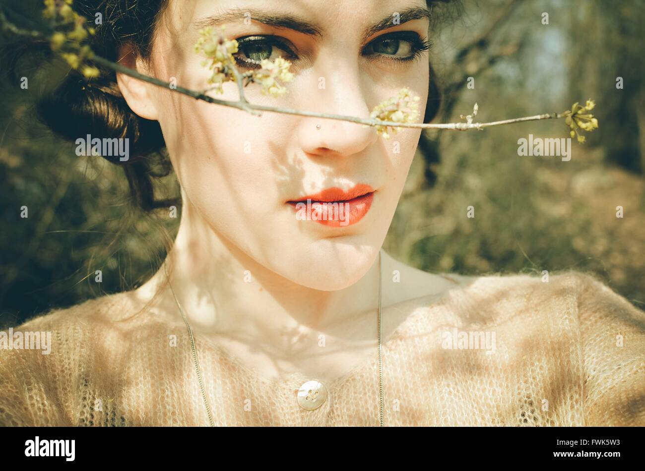 Portrait Of Beautiful Woman By Twig - Stock Image