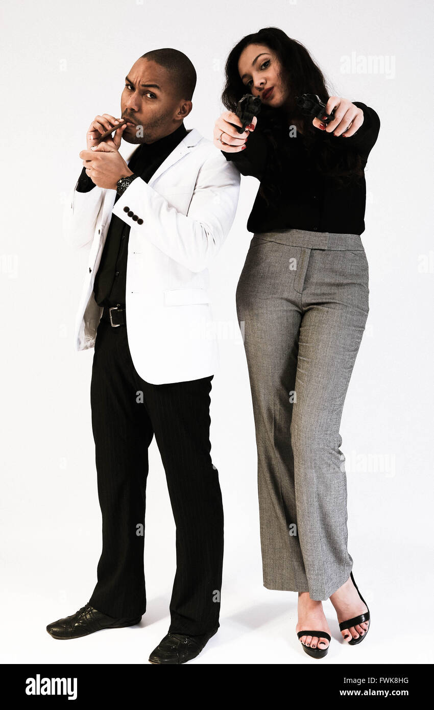 Portrait Of Fashionable Gangster Friends Against White Background - Stock Image