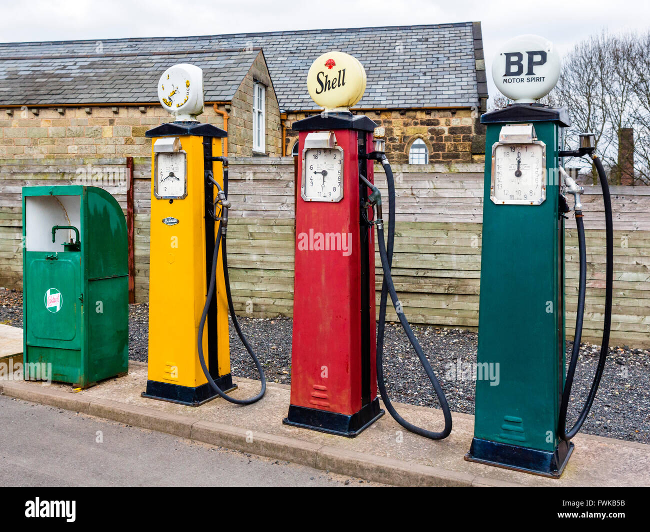 Old fashioned petrol pumps at a garage in the Black Country Living Museum, Dudley, West Midlands, UK - Stock Image