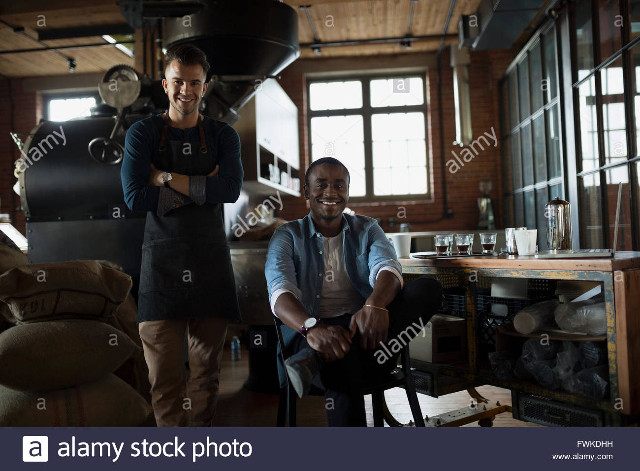 Portrait confident entrepreneurial coffee roasters - Stock Image
