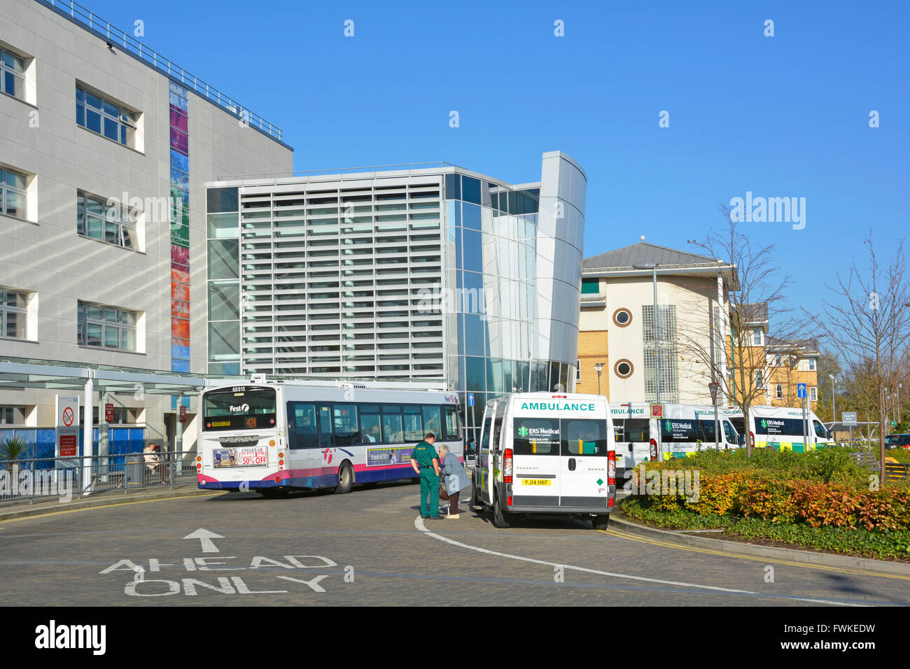 Bus stops & out patient NHS ambulances parking outside main entrance to Broomfield national health service Hospital - Stock Image