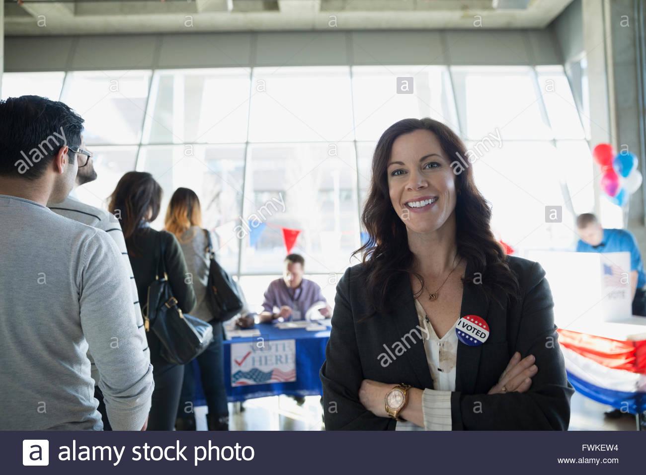 Portrait confident smiling woman at voter polling place - Stock Image