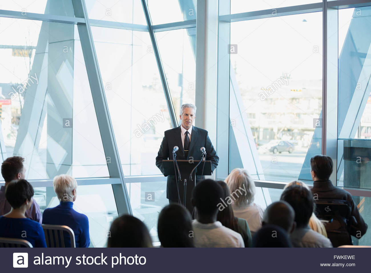 Politician speaking to audience at political rally - Stock Image