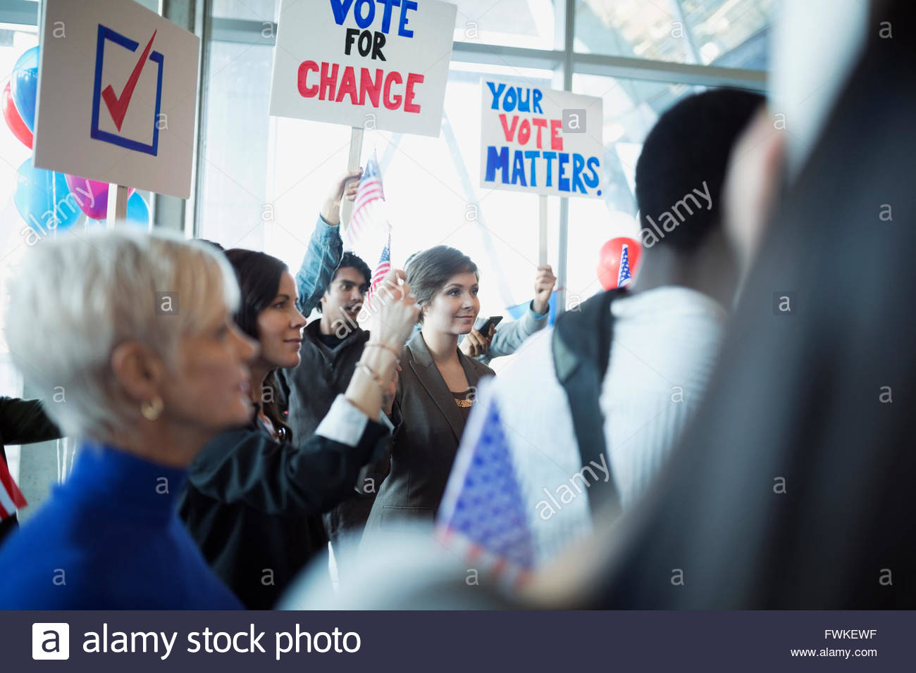 Audience with signs at political rally - Stock Image