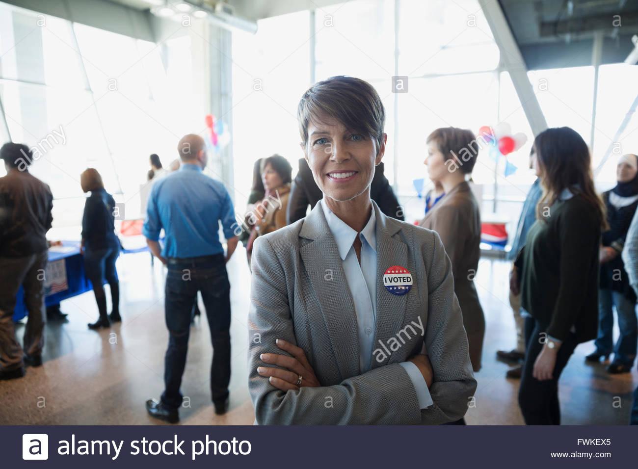Portrait confident businesswoman at voter polling place - Stock Image