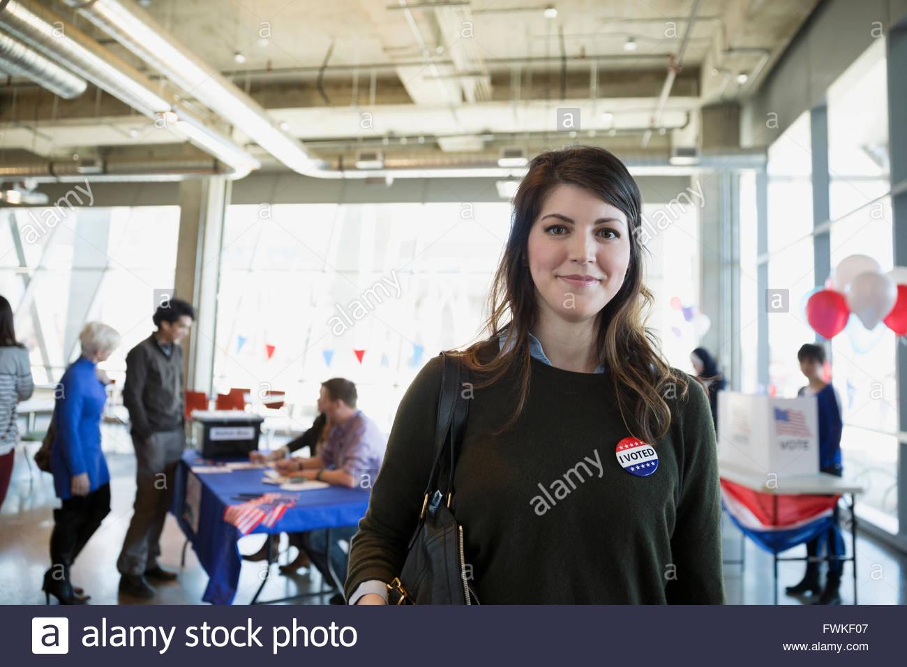 Portrait confident woman at voter polling place - Stock Image
