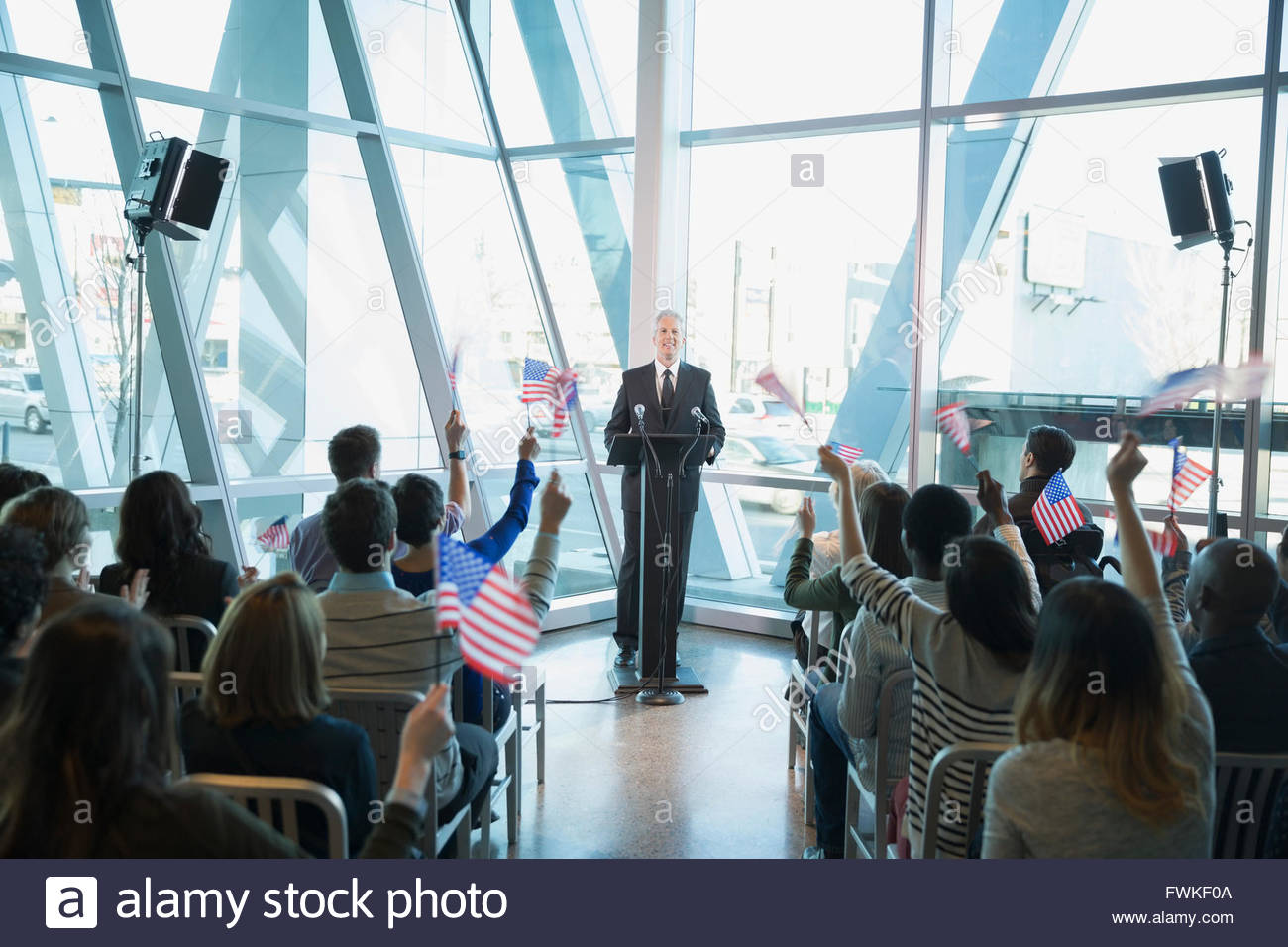Crowd waving American flags at political rally - Stock Image