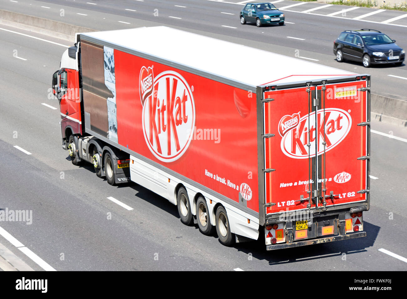 Transportation logistics Kit Kat chocolate bar & wrapper graphics on side of articulated trailer advertising - Stock Image
