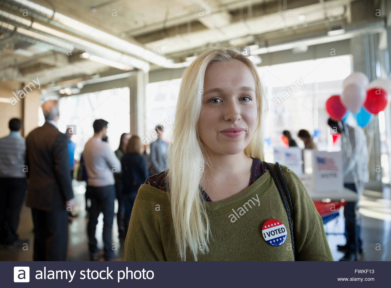Portrait confident young woman at voter polling place - Stock Image