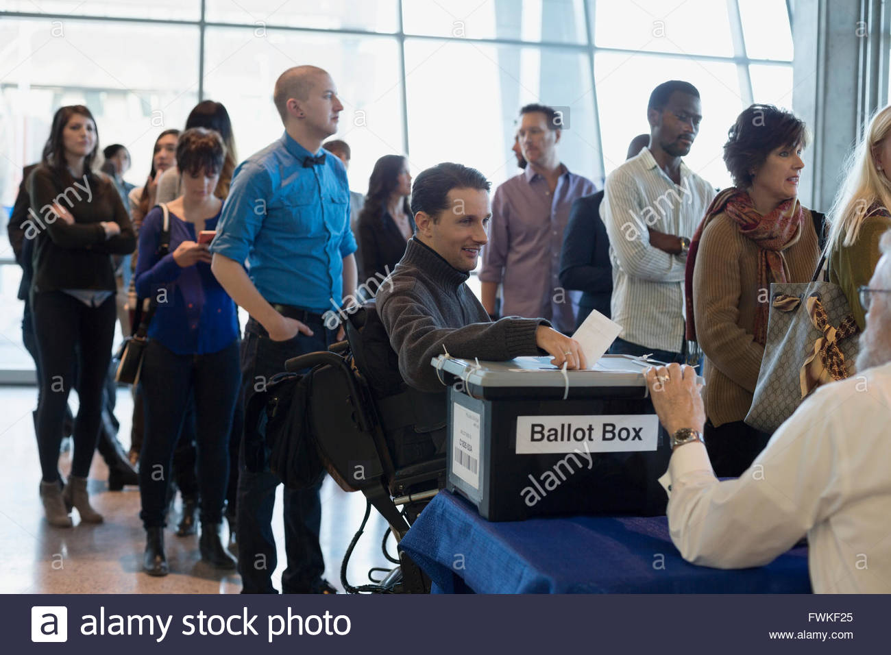 Voters waiting in line at polling place - Stock Image