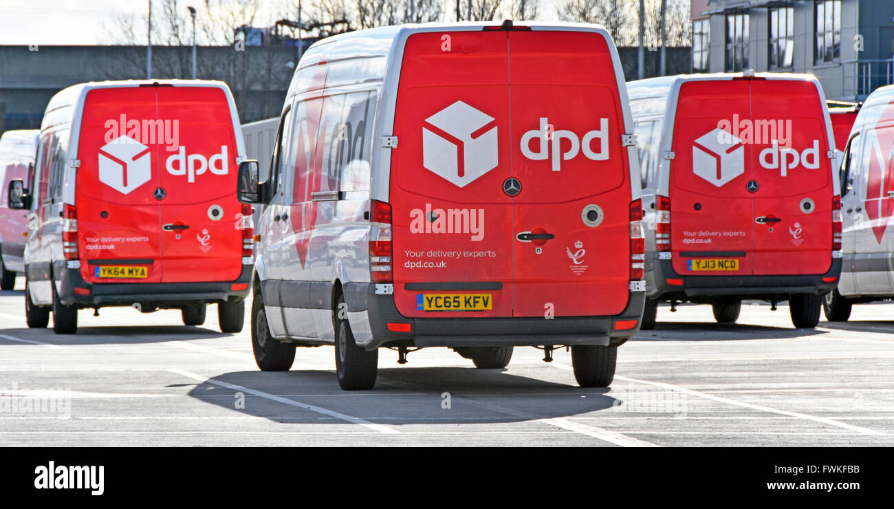 dpd parcel delivery vans parked in secure sorting & distribution vehicle transport depot Dagenham East London - Stock Image