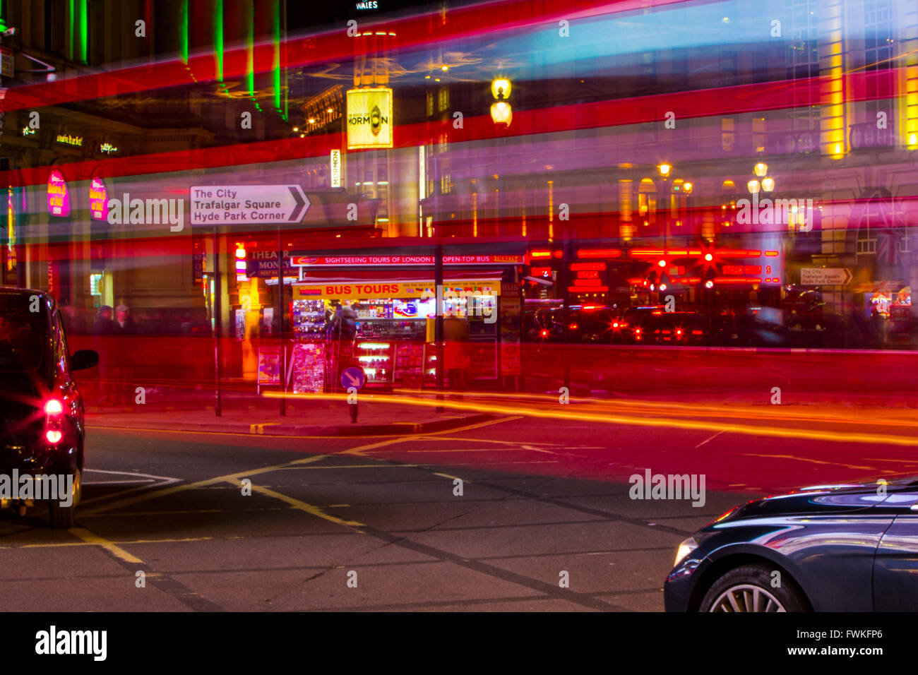 London Bus light trails night time Piccadilly circus black Cab taxi long exposure - Stock Image