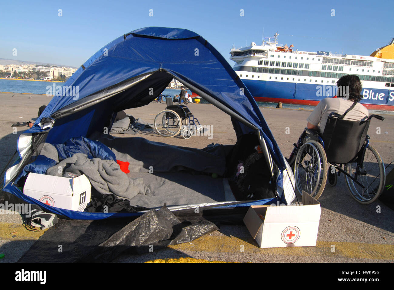 Refugee camp in Pireus Port. In the picture a disabled man seriously injured during the war in Syria . Most of migrants - Stock Image