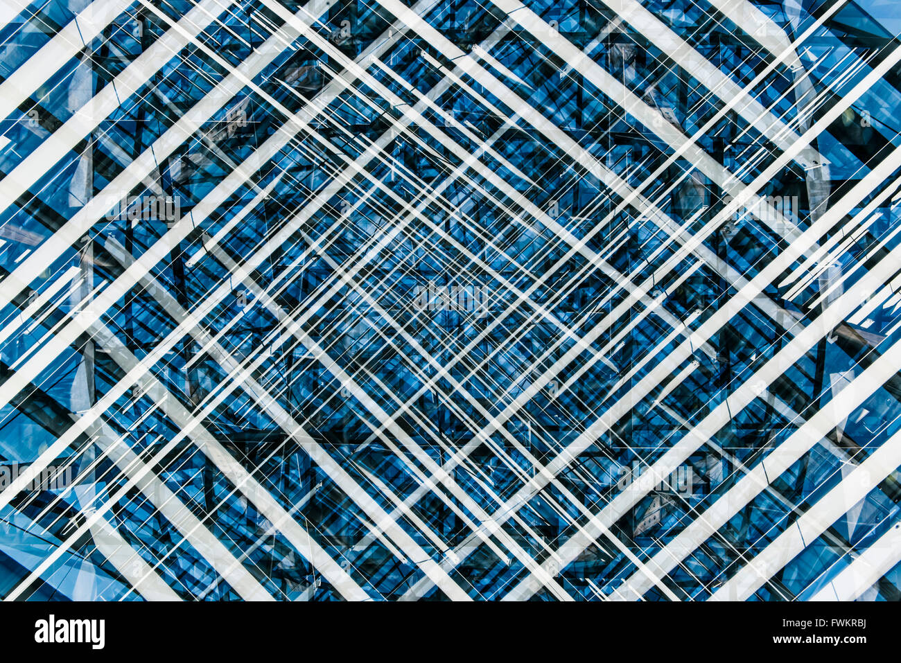 Blue, Black and White abstract pattern created using multiple exposures of an architectural detail. - Stock Image