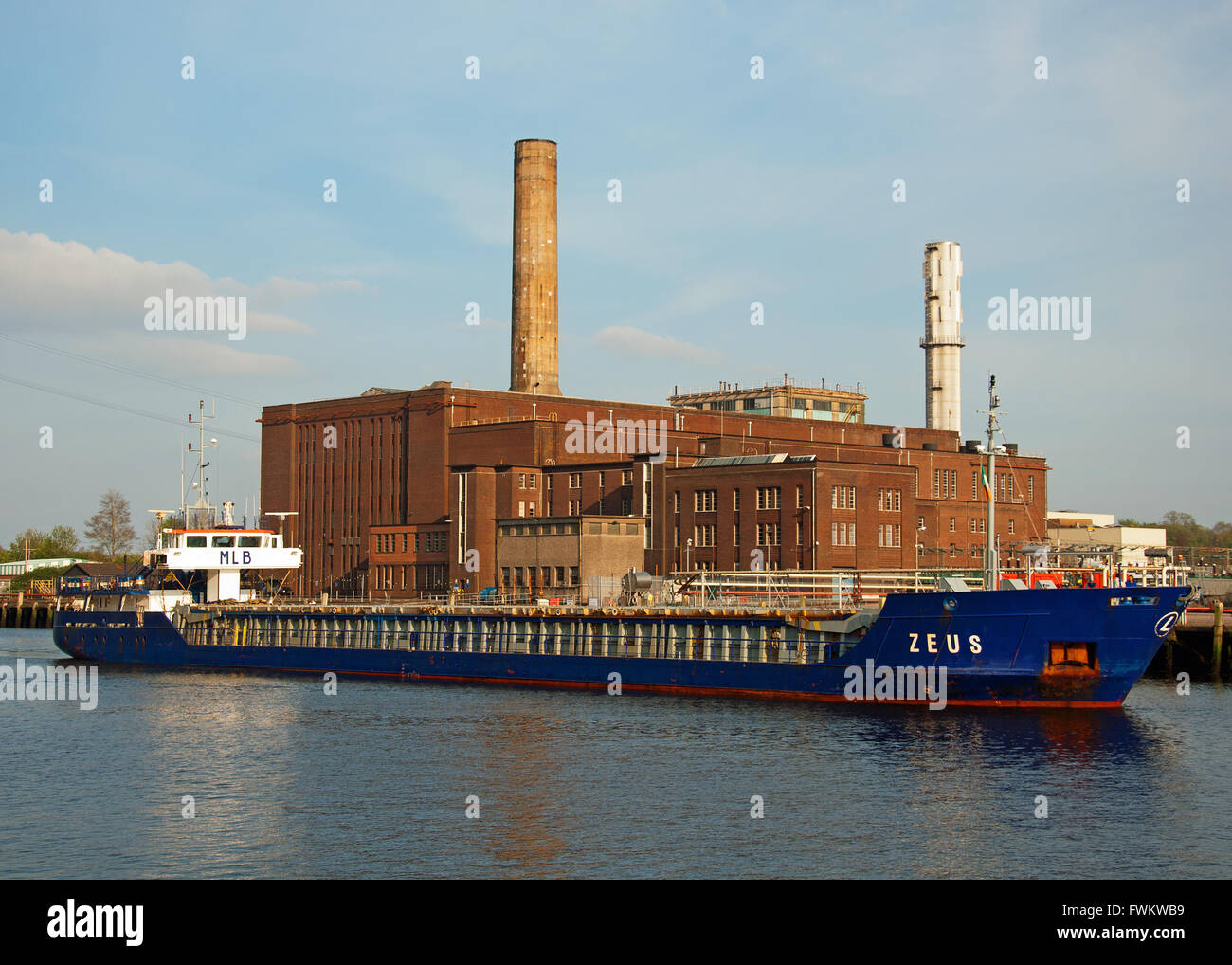 General cargo ship Zeus approaches the city quays in Cork, Ireland. - Stock Image