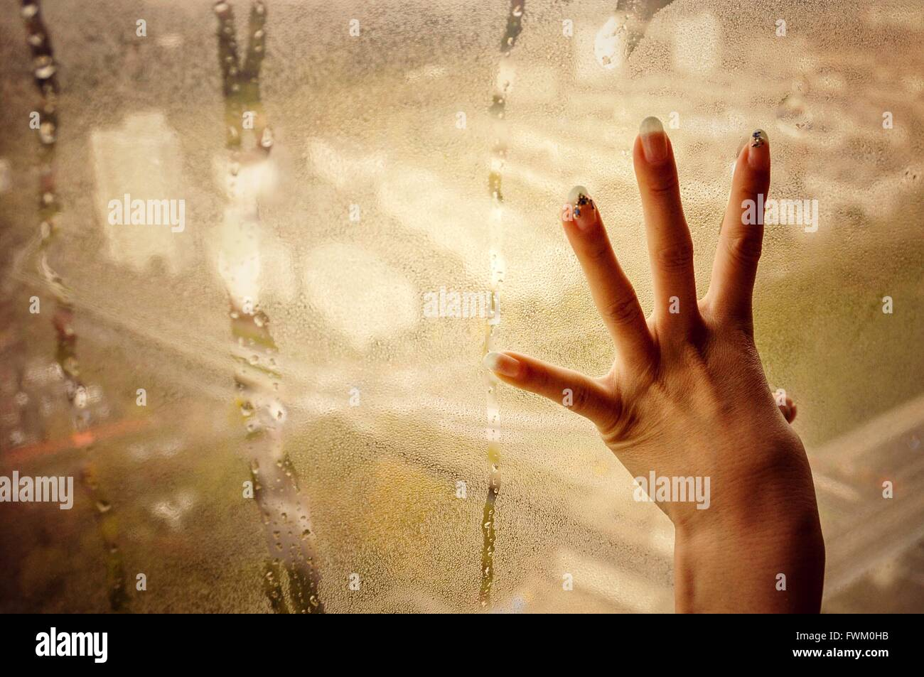 Cropped Hand On Condensed Glass - Stock Image