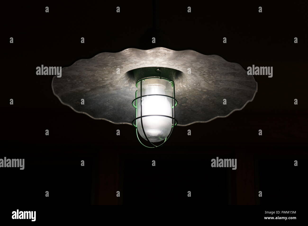 Low Angle View Of Illuminated Electric Bulb - Stock Image