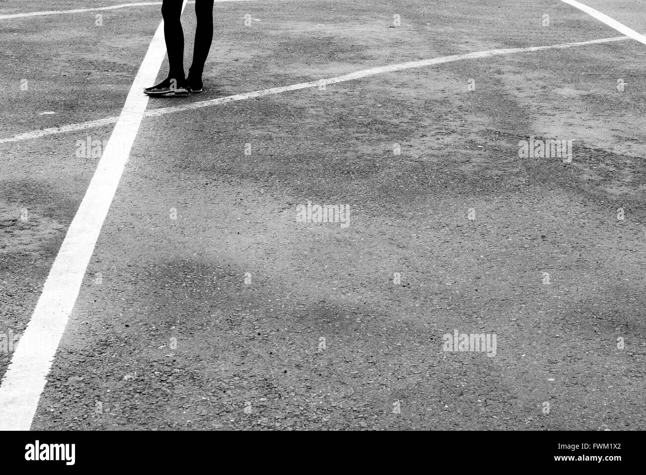 Low Section Of Woman Standing On Road - Stock Image