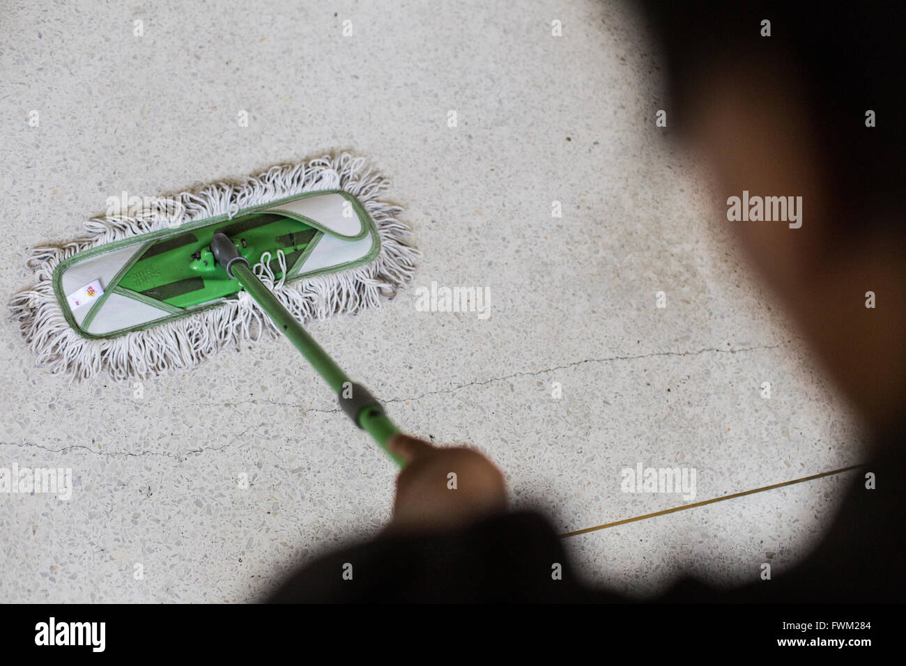 Cropped Image Of Person Cleaning Floor With Mop - Stock Image