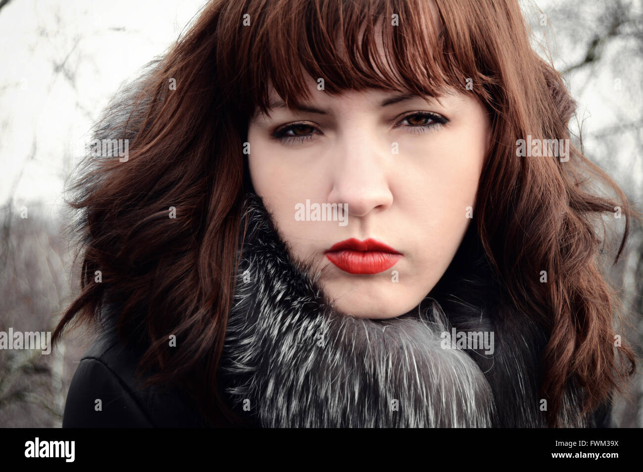 Portrait Of Beautiful Woman Wearing Fur Jacket - Stock Image