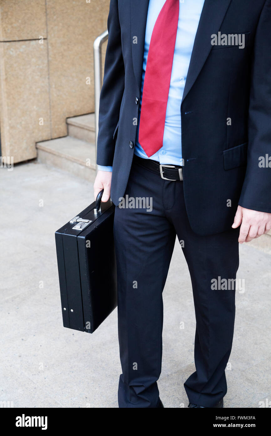 Businessman with attache case - Stock Image